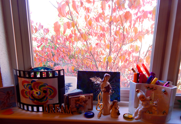 One of my window sill altars with our beloved dogwood smiling fall brilliance!